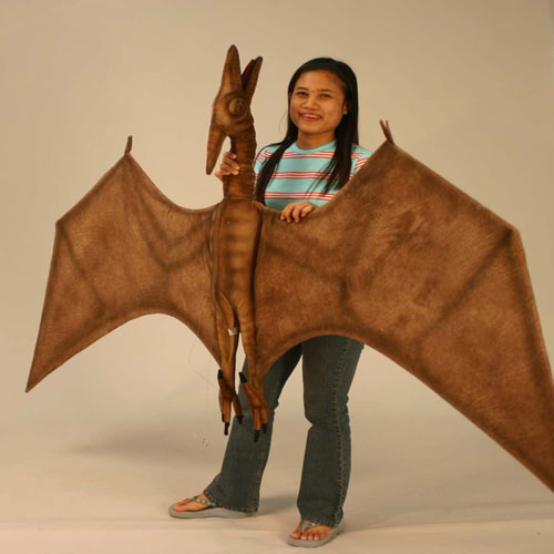 percy the pterodactyl is shown with girl holding it shown in brown