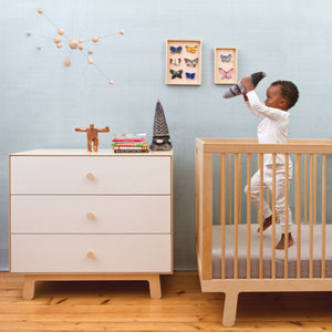 marshall dresser shown in white and birch with marshall crib beside it in birch