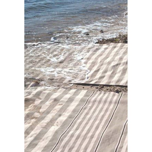 wilson stripe rug in silver and ivory showing two rugs by ocean
