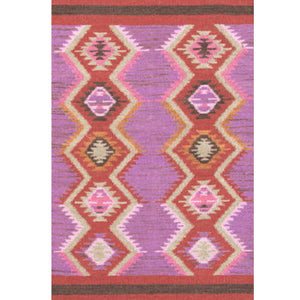 frida rug shown with two rows of diamond pattern in reds and oranges on a purple and pink background