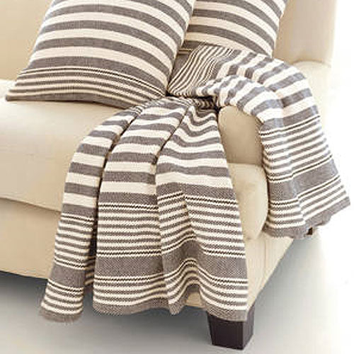 marley charcoal throw shown with matching accent pillows showing charcoal horizontal stripe with white