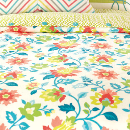 close up of ashlynn floral bedding showing blue, green, red, yellow and white