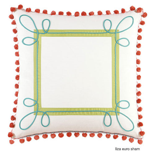 ashlynn pom pom accent pillow shown with white background and green border with blue accents in corners and red pom poms