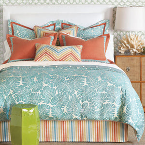 polly bedding shown with turquoise palm duvet and tangerine/aqua stripe bedskirt with coordinating accent pillows in tangerine and turquoise palm