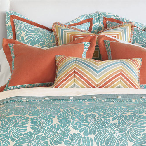 close up of polly bedding accent pillows shown in tangerine and aqua