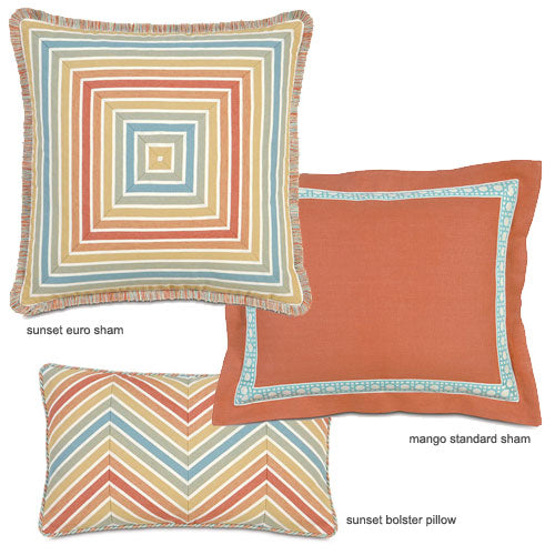 close up of polly accent pillow with tangerine and aqua colors