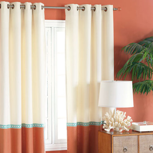 tangerine and aqua curtain panels shown in room with tangerine wall with ivory, aqua and tangerine curtains shown on silver window treatment hardware