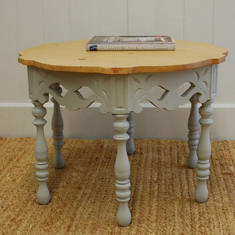 lizzie side table has unique pattern under table top with cutouts and sculpted turned legs shown with natural pine top and gray painted base