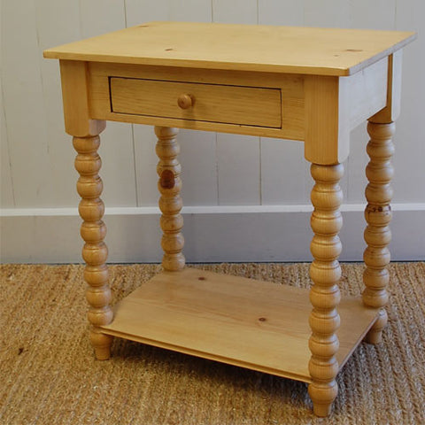 dinah night table shown in english pine stain with one single drawer and shelf on bottom to hold an item