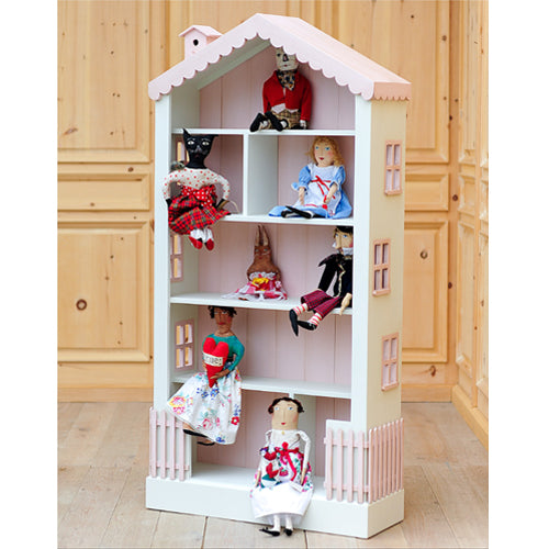 olivia bookcase shown in pink and white with pink beadboard with scalloped pink roof and pink birdhouse with pink fence shown with dolls on shelves