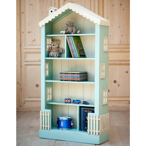 olivia bookcase shown in blue with cream scalloped roof trim with cream birdhouse with cream windows and picket fence in cream