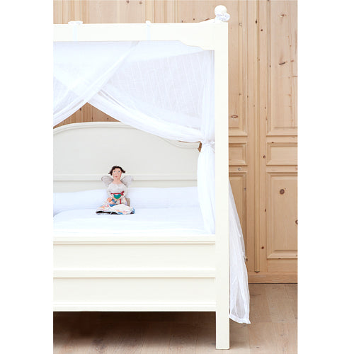 clover canopy bed shown with canopy fabric and doll