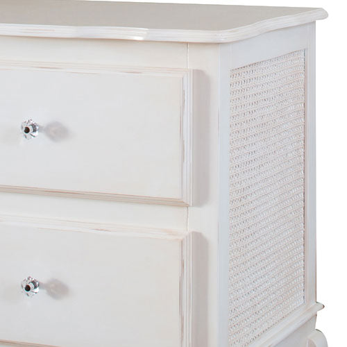 harper nightstand shown in white with close up of glass vintage knobs on drawers and caning details on sides