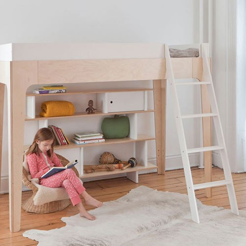 miller loft bed in twin shown with white ladder on right with girl sitting below reading with bookcase in the back