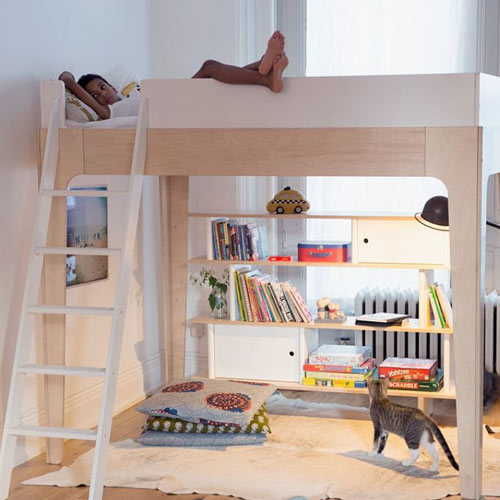 twin miller bunk bed shown in bedroom with boy lounging on top with white ladder on left with bookcase below