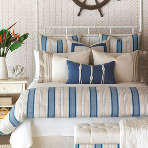 nautical bedding featuring ivory and blue stripe duvet and accent pillows including a navy nautical knot pillow with ivory rope