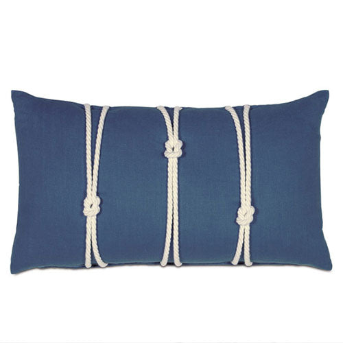 close up of navy nautical lumbar pillow featuring knots in ivory