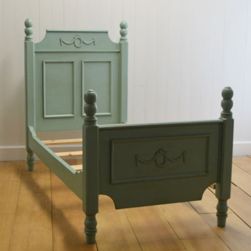 elsie bed shown in a seafoam finish with raised panels and wreath appliques shown in a twin
