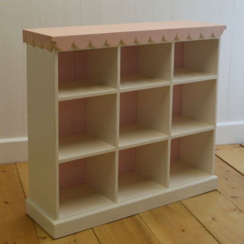 scalloped 9 cubby unit shown in white with pink scalloped trim