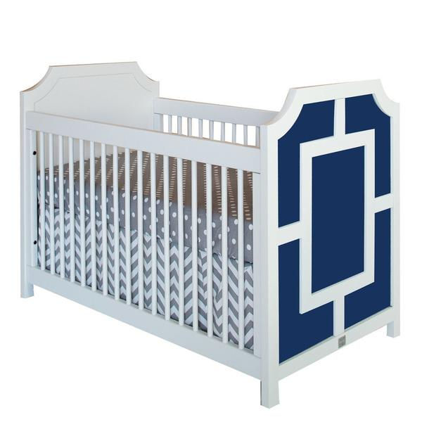 carter crib shown in navy with rectangle and moldings in white on headboard exterior shown here with gray polka dot bedding