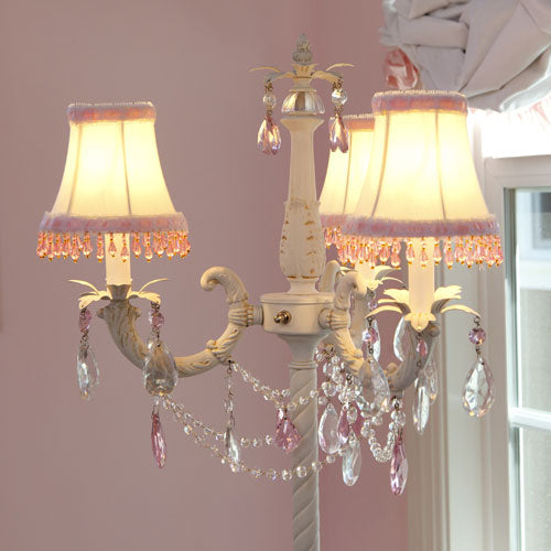 close up of paris floor lamp white shades with pink and clear crystals