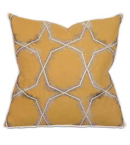 natalie accent pillow with white star like pattern on rustic yellow background