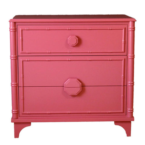 bahama drawer chest with three drawers shown in pink with bamboo finished on the ends