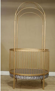round gold crib with open dome canopy