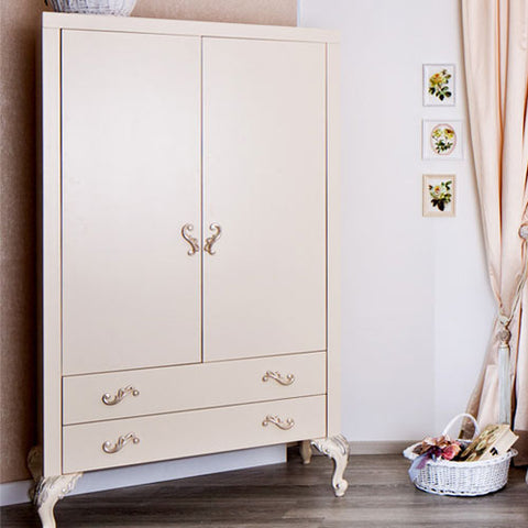 chelsea armoire shown in white with silver gilding with two doors with drawers below and hand carved feet