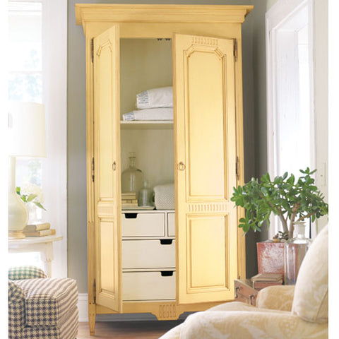 melissa armoire photo shows both doors open showing interior four drawers in vanilla bean while exterior is in a yellow called creme brulee