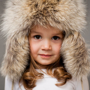 close up of light brown frost coyote dior fur hat shown on little girl