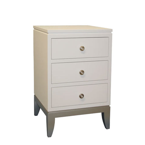 camila night stand shown in white with three drawers with glam knobs and silver base