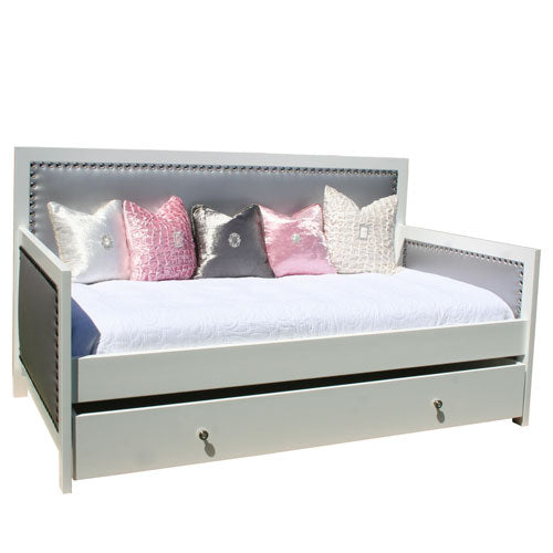 camila daybed with gray upholstered back and sides with nailhead trim with trundle with designer knobs shown with white, pink and gray accent pillows