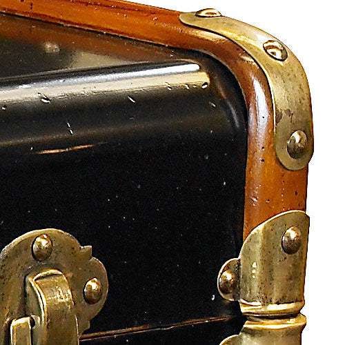 close up of black cherry trunk with brass hardware