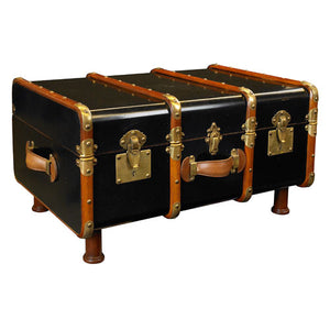 black cherry trunk accented with brass hardware for a coffee table