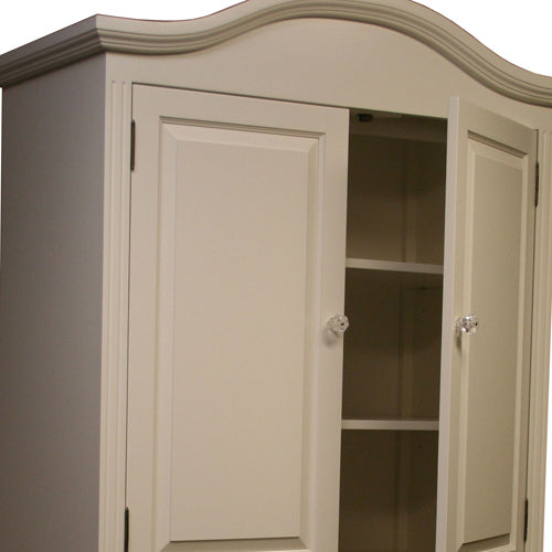 close up of mary claire armoire showing doors slighting ajar showing two adjustable shelves in swiss coffee finish