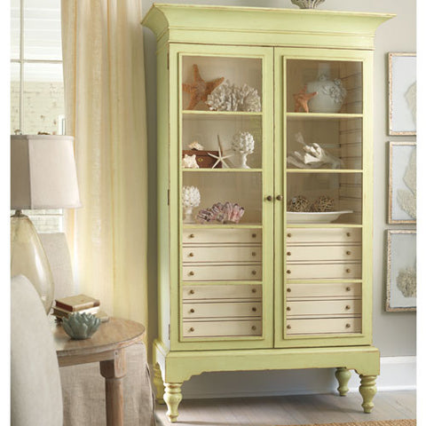 braxton display case shown in key lime with vanilla bean interior drawers with two glass doors with two shelves and top of drawers making a third shelf
