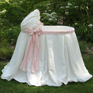 emery bassinet draped with irish linen in ivory with baby pink sash and bow