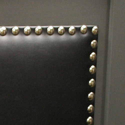 close up of tate headboard showing black faux leather with silver nailheads