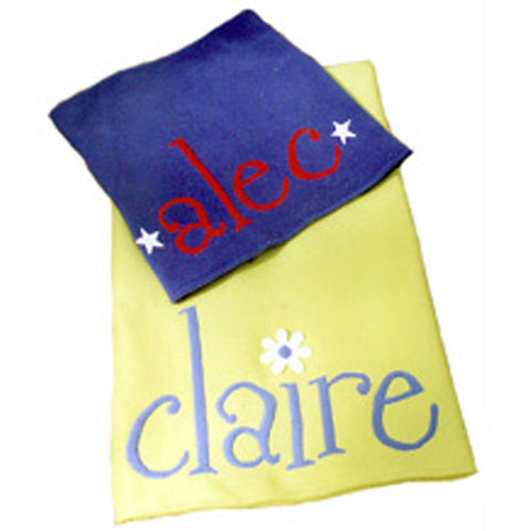 "claire personalized fleece blanket shown yellow with periwinkle lettering ""claire"" with flower accent over i on yellow background.  Blue blanket with red lettering in alec with white star on each side of name."
