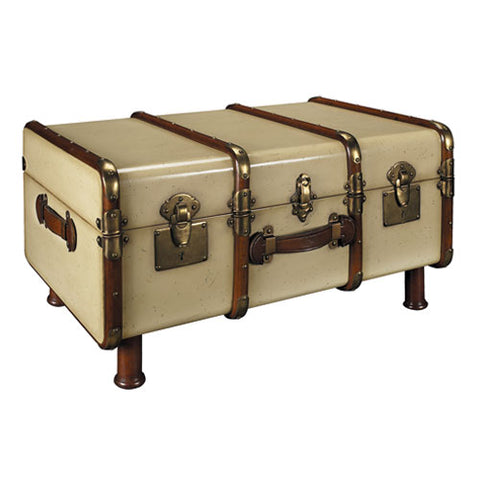 trunk like suitcase coffee table shown in cream with highlights in dark brown stain with antique brass hardware