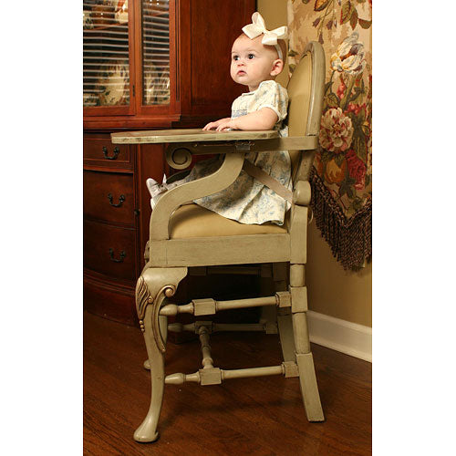 side of the distressed sage highchair shown with baby in chair shown
