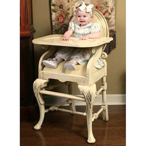 distressed ivory oval highchair shown with baby girl sitting in chair