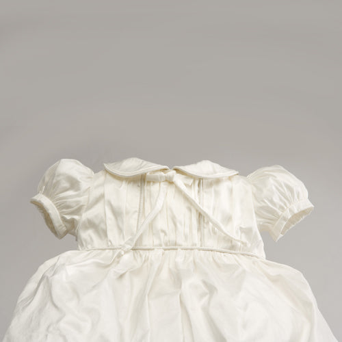 close up of willow christening dress showing all details in white dupioni white silk
