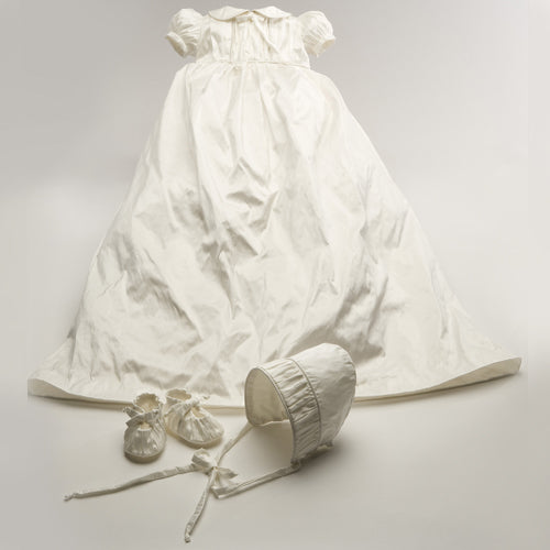 willow christening dress shows fully lined dress, booties and bonnet all seamed in white dupioni silk