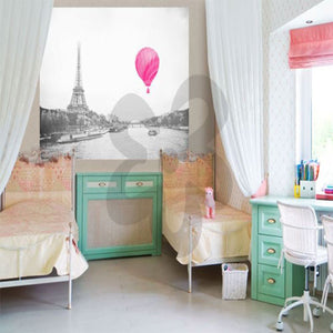 eiffel tower wall decal shown in a bedroom with bed and green case pieces