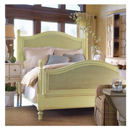 plantation cane bed shown in key lime with caning on headboard and footboard with decorative finials