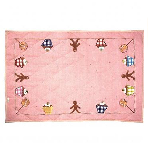 cupcake cottage floor quilt with pink background with cupcake, gingerbread man and lollipop on border