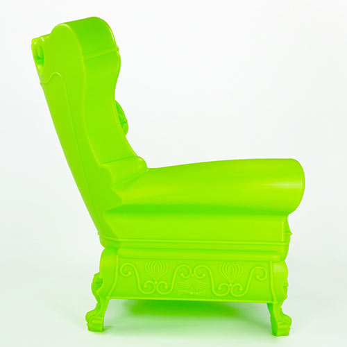 side profile of trudy youth chair shown in bright lime with european style made with recycled polyethylene