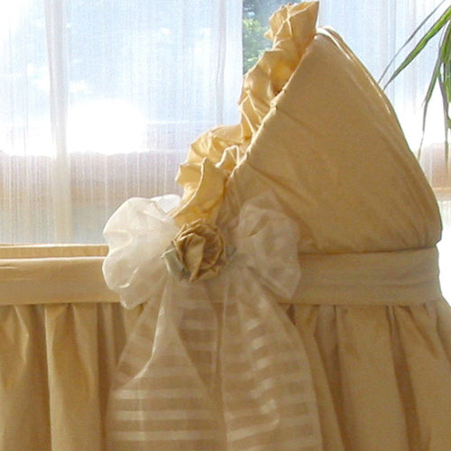 close up of remi bassinet showing flower centered on sheer silk organza stripe bow